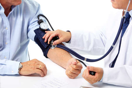 health insurance: Blood pressure measuring. Doctor and patient. Stock Photo