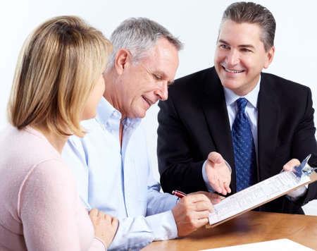 financial agreement: Senior couple with financial adviser.