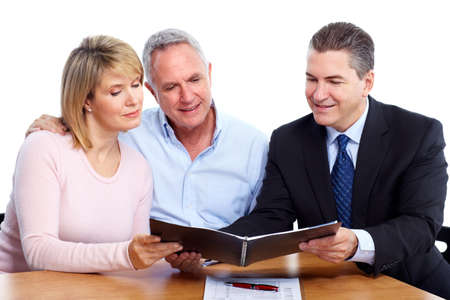 financial insurance: Senior couple with financial adviser.