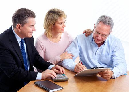 Senior couple with financial adviser. Stock Photo - 11454649