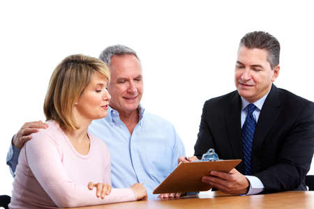 financial planner: Senior couple with financial adviser.