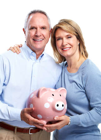 money man: Senior couple with a piggy bank.