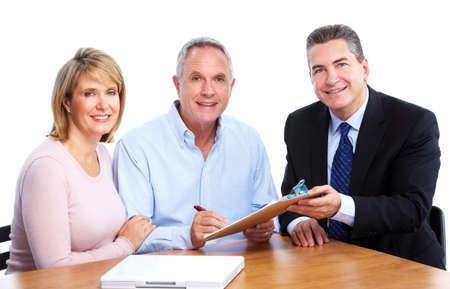 Senior couple with financial adviser. photo