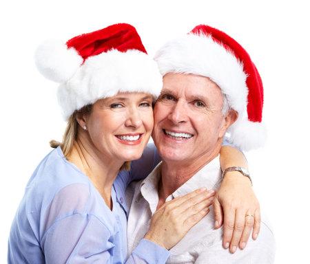 Happy senior Christmas Santa couple.