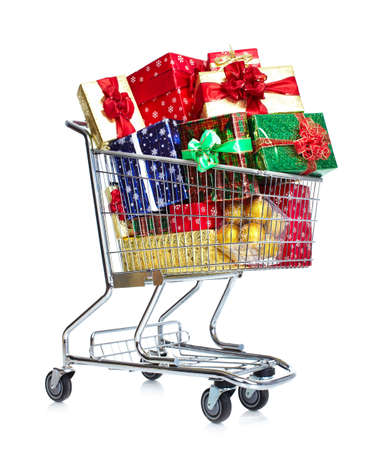 Christmas shopping cart with gifts. photo