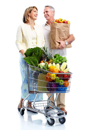 consumer: Senior couple with a grocery shopping cart. Stock Photo