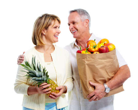 Senior couple with a grocery shopping bag. photo