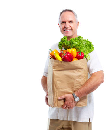 food sales: Senior man with a grocery shopping bag.