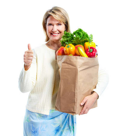 vegetables supermarket: Senior woman with a grocery shopping bag.