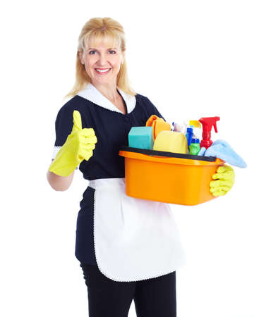 Domestic cleaning: Smiling maid woman. Stock Photo