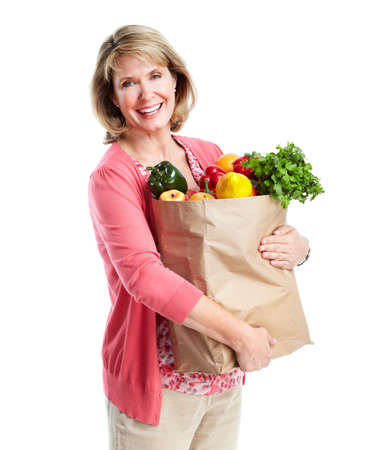 grocery stores: Senior woman with a grocery shopping bag.