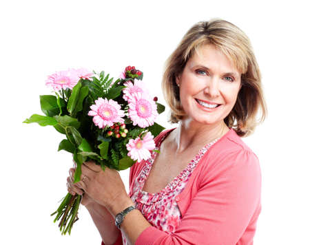 Happy senior woman with flowers. photo