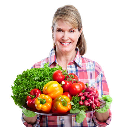 Senior woman with vegetables. photo