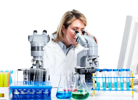 Woman working with a microscope in a laboratory.