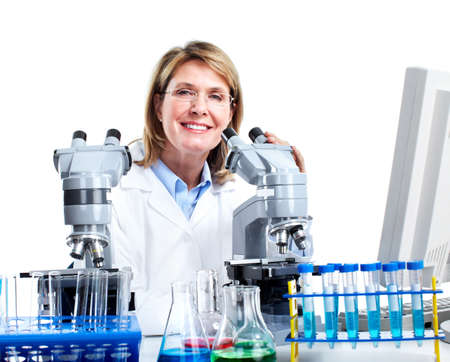optical equipment: Woman working with a microscope in a laboratory.