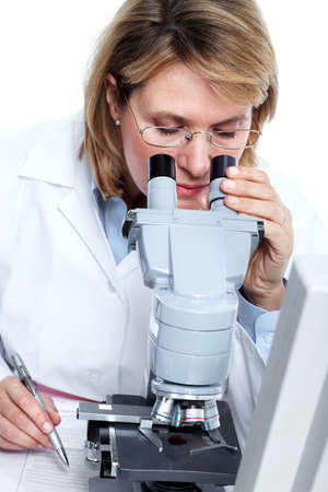 Woman working with a microscope in a laboratory. Stock Photo - 11464660