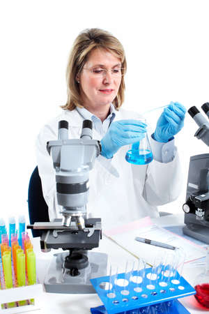 Woman working with a microscope in a laboratory. Stock Photo - 11456618