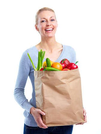 Young woman with a grocery shopping bag. Stock Photo - 11456630