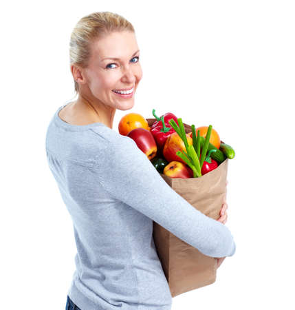 Young woman with a grocery shopping bag. photo