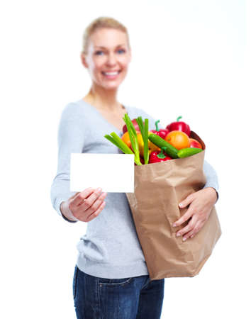 grocery shopping: Young woman with a grocery shopping bag. Stock Photo