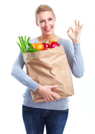 Young woman with a grocery shopping bag. Stock Photo - 11456637
