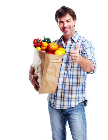 man shopping: Man with a grocery bag.
