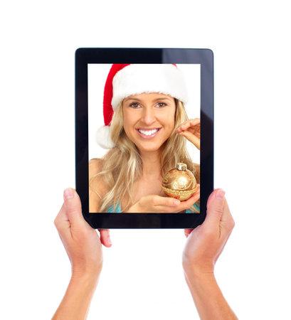 Tablet computer and Christmas girl. photo