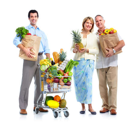 shopping cart: Family with a grocery shopping cart. Stock Photo