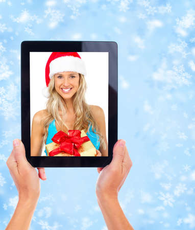 Tablet computer and Christmas girl. Stock Photo - 11478638