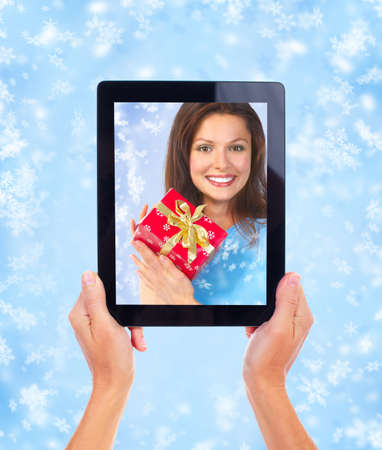 Tablet computer and Christmas girl. Stock Photo - 11478636