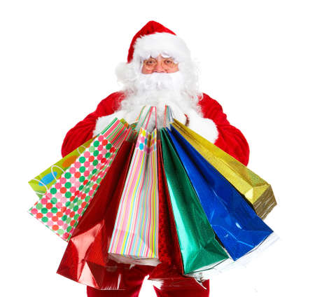 Kerstman met een shobbing zak. Stockfoto