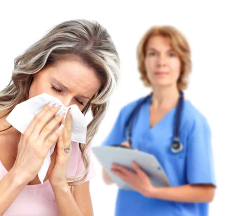 Sneezing girl and doctor. photo