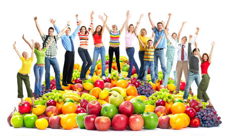 nutrition health: Group of happy people with fruits. Stock Photo