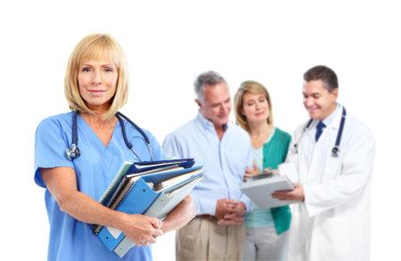 Arts en bejaarde echtpaar patiënt. Stockfoto