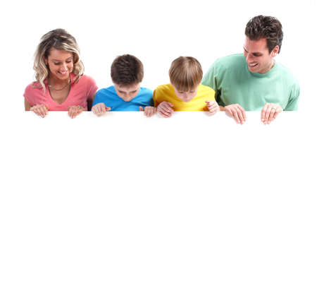 Happy family with banner. Stock Photo