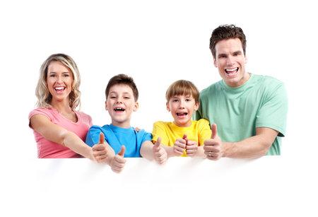 ni�os con pancarta: Familia feliz con la bandera. Foto de archivo