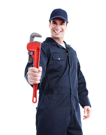 Plumber with an adjustable wrench. photo
