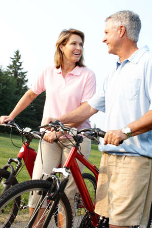 velo: Senior couple cycling in park