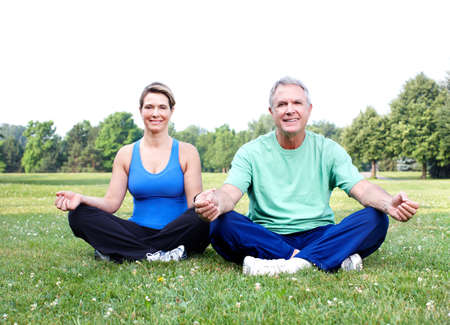 Senior couple doing yoga  photo