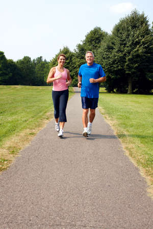 Senior couple jogging in park.