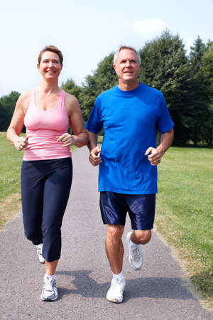Senior couple jogging in park  photo