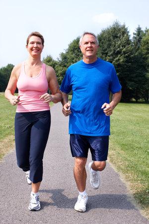 people running: Senior couple jogging in park