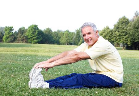 senior yoga: Senior man doing yoga  Stock Photo