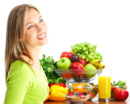 Young woman with fruits and vegetables. photo