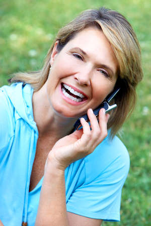 old cell phone: Senior woman. Stock Photo