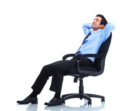 resting: Relaxing handsome businessman. Stock Photo