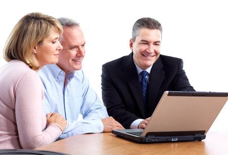 financial adviser: Senior couple with financial adviser.