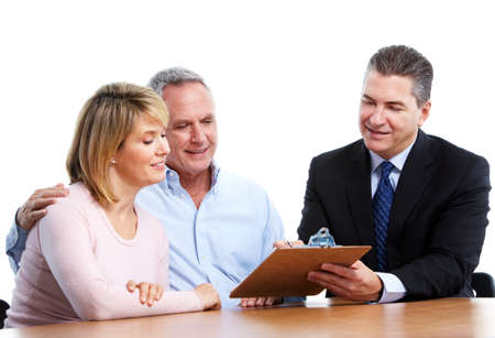 financial security: Senior couple with financial adviser.