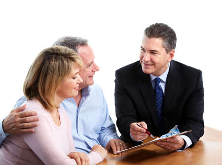 Senior couple with financial adviser. Stock Photo - 12137603