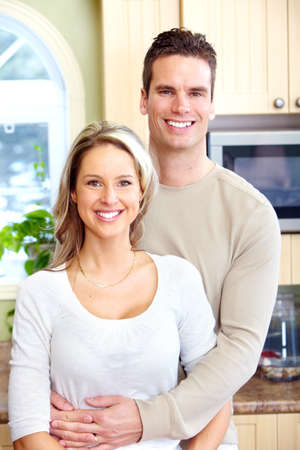 Happy couple at home. Stock Photo - 12137643